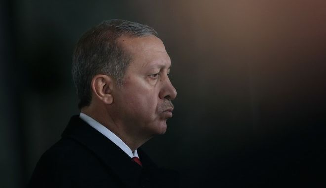 Turkish President Recep Tayyip Erdogan stands at the mausoleum of Turkey's founder Mustafa Kemal Ataturk in Ankara, Turkey, Tuesday, Nov. 10, 2015, as leaders from the worlds 20 biggest economies gather for a summit in Turkey.  Erdogan certainly shares the concerns about the spillover of refugees and terrorism from nearby Syria that preoccupy leaders descending this weekend on the port town of Antalya, but despite the growing troubles for Turkey, he is buoyant as he prepares to host the event, basking in a surprise election victory for his party this month that has left no doubt that he is the key regional player for talks on refugees and terrorism.(AP Photo/Burhan Ozbilici)