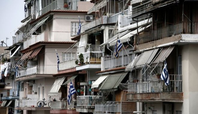 Greek flags on balconies eve of National Day March 25, 1821. Thessaloniki, Greece on March 24, 2014. /         25  1821. ,   24  2014.