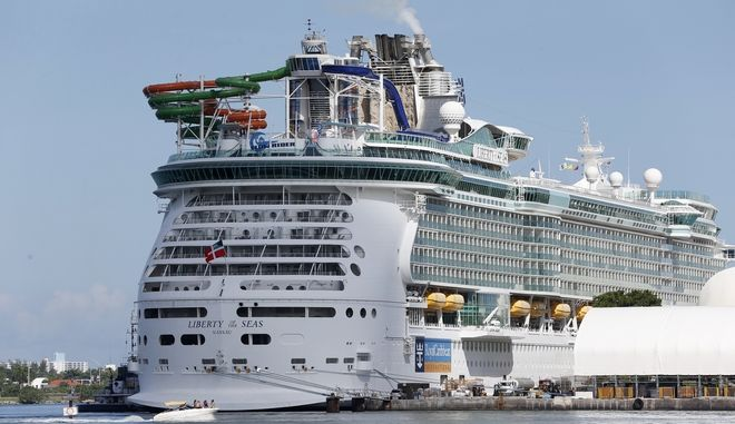 The Royal Caribbean International cruise ship Liberty of the Seas is docked, Tuesday, Aug. 29, 2017, at PortMiami in Miami. The Galveston, Texas-based cruise ship was scheduled to return to the city Sunday but was diverted to Miami, because of Hurricane Harvey. (AP Photo/Wilfredo Lee)