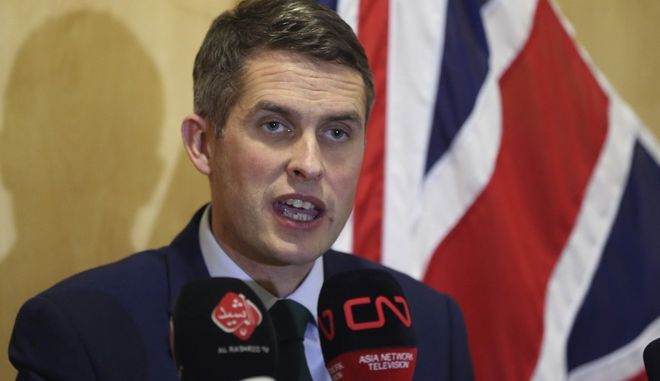 In this Thursday, Jan. 4, 2018 Picture Britain's Defense Secretary Gavin Williamson holds a news conference in British embassy in Baghdad, Iraq. (AP Photo/Karim Kadim)