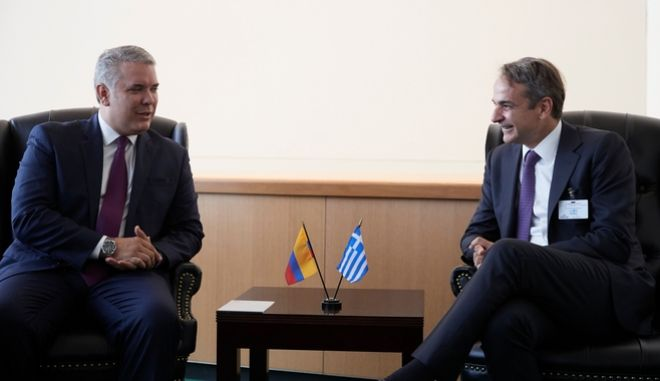 O πρωθυπουργός με τον Πρόεδρο της Κολομβίας.