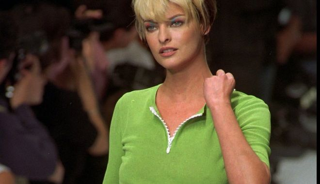 Canadian top model Linda Evangelista wears a green sweater with slide fasteners and a see-through muslin long skirt for Chloe's 1996 spring/summer ready-to-wear collection designed by German fashion designer Karl Lagerfeld and presented in Paris Monday October 16, 1995. (AP PHOTO/Remy de la Mauviniere)