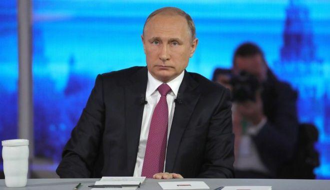 Russian President Vladimir Putin listens during his annual televised call-in show in Moscow on Thursday, June 15, 2017.(Mikhail Klimentyev/Sputnik, Kremlin Pool Photo via AP)