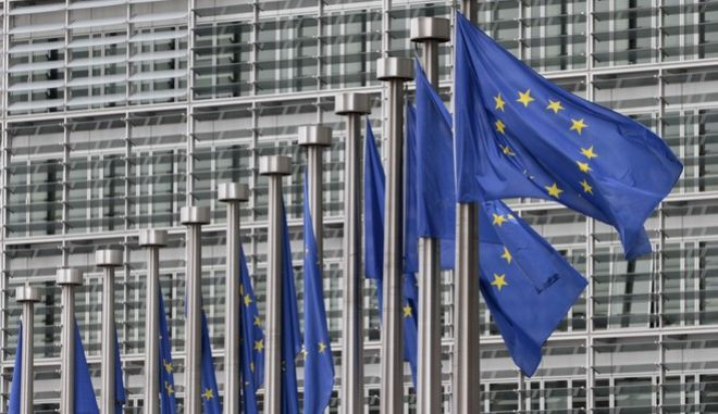 FILE - In this May 9, 2011 file photo, EU flags fly at the European Commission headquarters in Brussels. The European Union has been awarded Spain's Princess of Asturias 2017 Concord Prize for its work in harmonizing relations between its member nations, the prize organizers announced Wednesday June 21, 2017. (AP Photo/Yves Logghe)