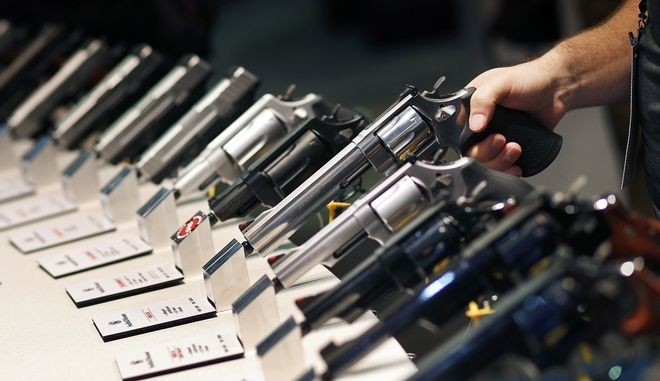 FILE - In this Jan. 19, 2016 file photo, handguns are displayed at the Smith & Wesson booth at the Shooting, Hunting and Outdoor Trade Show in Las Vegas. The largest gun industry trade show will be taking place in Las Vegas Jan. 23-26 just a few miles from where a gunman carried out the deadliest mass shooting in modern U.S. history. (AP Photo/John Locher, File)