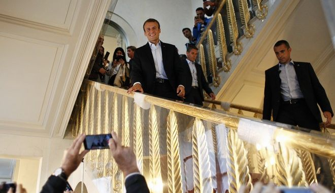 French President Emmanuel Macron greets visitors in the Elysee presidential palace in Paris, Sunday, Sept. 17, 2017 as part of the 34th edition of France's heritage open days. The national buildings and administrations of France are open to the public for the Heritage Days weekend. (AP Photo/ Thibault Camus, Pool )