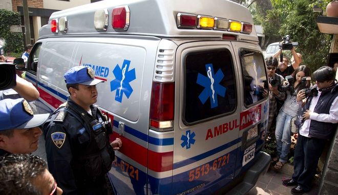 An ambulance carrying Gabriel Garcia Marquez arrives to his home from the hospital in Mexico City, Tuesday, April 8, 2014. A medical official says the Colombian author and Nobel literature laureate has left the hospital where he was treated for eight days for pneumonia and related problems. (AP Photo/Eduardo Verdugo)