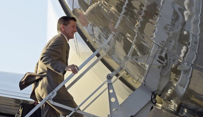 National Security Adviser Michael Flynn boards Air Force One at Palm Beach International Airport in West Palm Beach, Fla., Sunday, Feb. 12, 2017, as he return to Washington with President Donald Trump. (AP Photo/Susan Walsh)