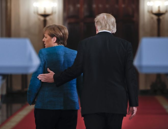 President Donald Trump and German Chancellor Angela Merkel walk down the White House Cross Hall in Washington after participating in a joint news conference, Friday, March 17, 2017. (AP Photo/Pablo Martinez Monsivais)