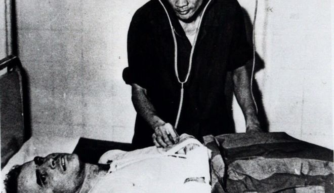 John McCain is administered to in a Hanoi, Vietnam hospital as a prisoner of war in the fall of 1967. McCain spent 20 years in the Navy, a quarter of it in a Vietnamese prisoner of war camp after his jet was shot down over Hanoi during a bombing mission Oct. 26, 1967.  The Navy pilot nearly gave up during his captivity but his memory of books and movies helped him survive. (AP Photo)