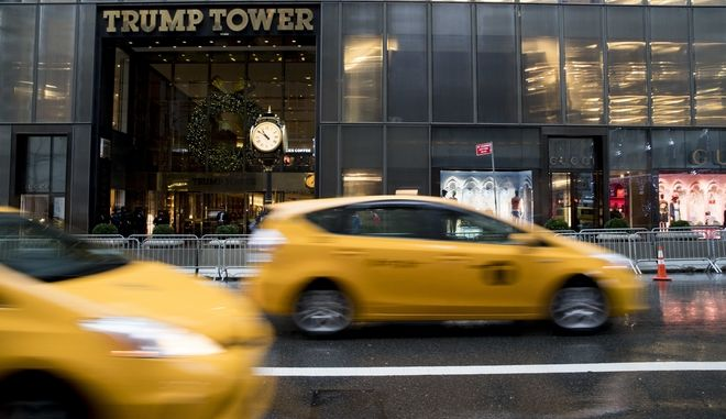 Traffic makes it's way down Fifth Avenue past Trump Tower, Tuesday, Nov. 29, 2016, in New York. (AP Photo/Mary Altaffer)