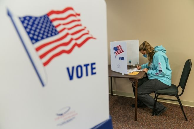 Brooke Hader, 18, votes for the first time since becoming old enough to be eligible, as she fills out her ballot during absentee early voting for the general election in Sterling Heights, Mich., Thursday, Oct. 29, 2020. (AP Photo/David Goldman)