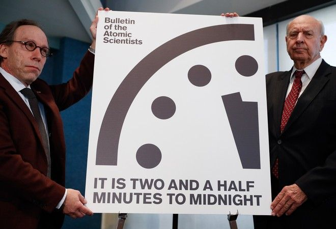 Lawrence Krauss, theoretical physicist, chair of the Bulletin of the Atomic Scientists Board of Sponsors, left, and Thomas Pickering, co-chair of the International Crisis Group, display the Doomsday Clock during a news conference the at the National Press Club in Washington, Thursday, Jan. 26, 2017, announcing that the Bulletin of the Atomic Scientist have moved the minute hand of the Doomsday Clock to two and a half minutes to midnight. (AP Photo/Carolyn Kaster)