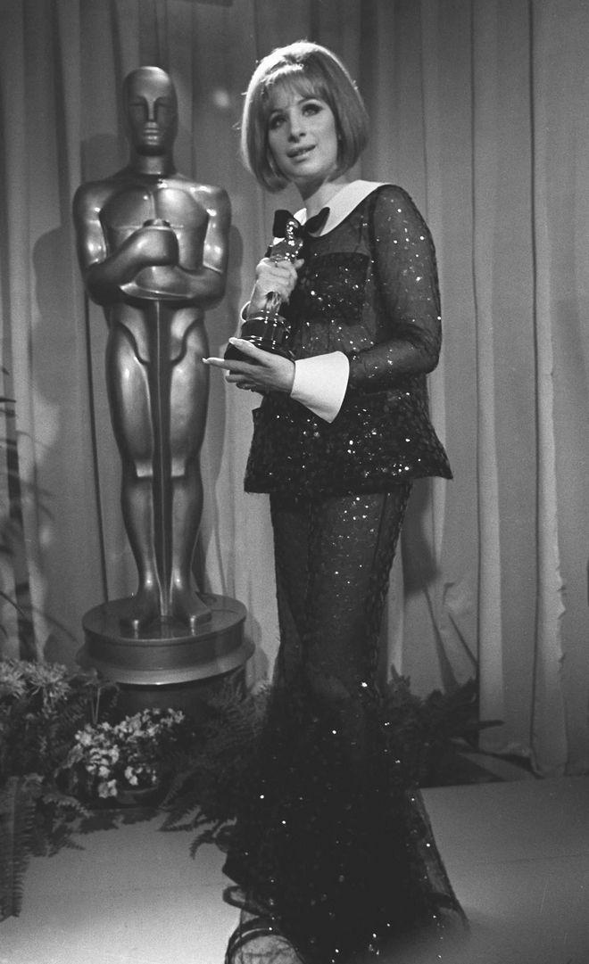 Barbra Streisand wins an Oscar for her performance in