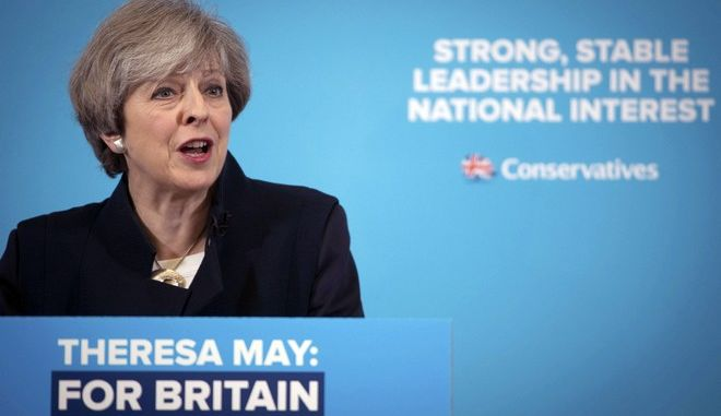 Britain's Prime Minister and Conservative leader Theresa May speaks to supporters in North Shields, Tyne and Wear, northeast England, Friday May 12, 2017. British voters head to the polls for a general election on June 8.  (Stefan Rousseau/PA via AP)