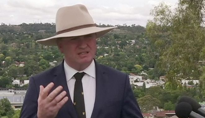 In this image made from video, Australian Deputy Prime Minister Barnaby Joyce speaks to reporters in Tamworth, Australia Friday, Feb. 23, 2018. Joyce resigned from Cabinet on Friday over allegations that he sexually harassed a woman. (Australia Broadcasting Corporation via AP)