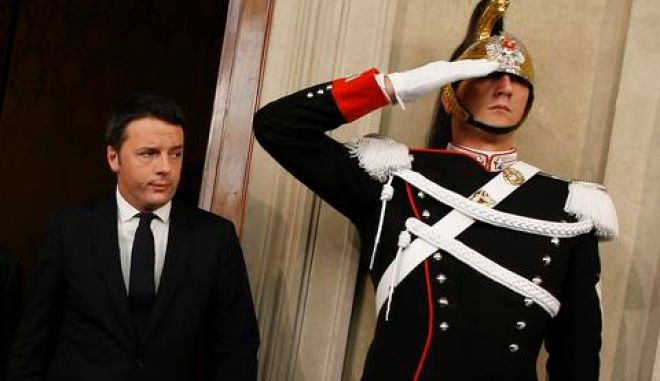 Leader of the Democratic Party Matteo Renzi arrives to speak to reporters at the end of consultations with Italian President Giorgio Napolitano at the Quirinale Palace in Rome February 17, 2014. Italian centre-left leader Renzi said on Monday he would begin talks to form a new government in the next 24 hours, and expected to lay out a programme of reforms to be completed within the next few months.REUTERS/Tony Gentile (ITALY - Tags: POLITICS)