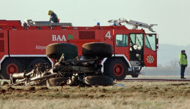 The wheels and undercarriage, of the British Airways Boeing 777 plane flying from China that landed short of the runway at London's Heathrow Airport, Thursday Jan. 17, 2008. The plane was flight BA38 from Beijing to London, British Airways said. The Boeing 777 made an emergency landing at 1242 GMT and all passengers were evacuated, airport operator BAA PLC said. Three passengers were assessed for minor injuries following the incident, London Ambulance Service said. The aircraft appeared to have landed just meters (yards) from a busy perimeter road, Britain's Press Association reported. The impact wrecked the undercarriage and caused extensive damage to both wings, the report said.  (AP Photo/Keith Hammett)