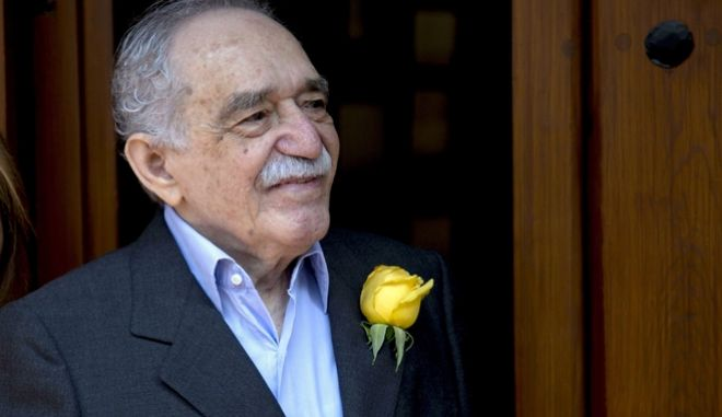 FILE - In this March 6, 2014 file photo, Colombian Nobel Literature laureate Gabriel Garcia Marquez greets fans and reporters outside his home on his 87th birthday in Mexico City. Colombia's Central Bank put into circulation on Friday, Aug. 19, 2016, the new 50,000 pesos bill, about $17.00 U.S. dollars, with the image of the Colombian writer. (AP Photo/Eduardo Verdugo, File)