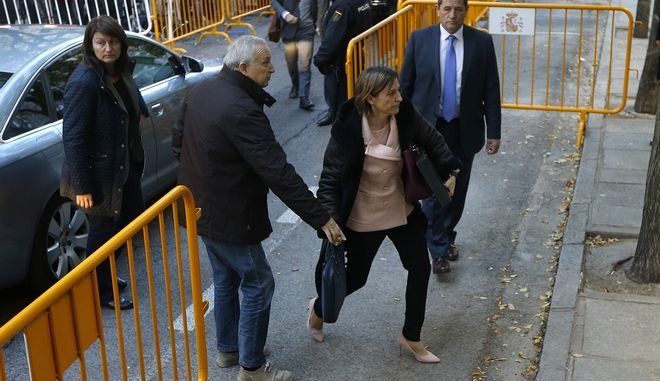 Ex-speaker of the Catalonia parliament Carme Forcadell , front right, arrives at the Spain's Supreme Court in Madrid, Thursday, Nov. 9, 2017. Six Catalan lawmakers are testifying Thursday before a Spanish judge over claims that they ignored Constitutional Court orders and allowed an independence vote in Catalonia's regional parliament. (AP Photo/Francisco Seco)