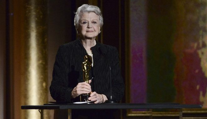 Actress and honoree Angela Lansbury accepts her award at the 2013 Governors Awards on Saturday, Nov. 16, 2013 in Los Angeles. (Photo by Dan Steinberg/Invision/AP)