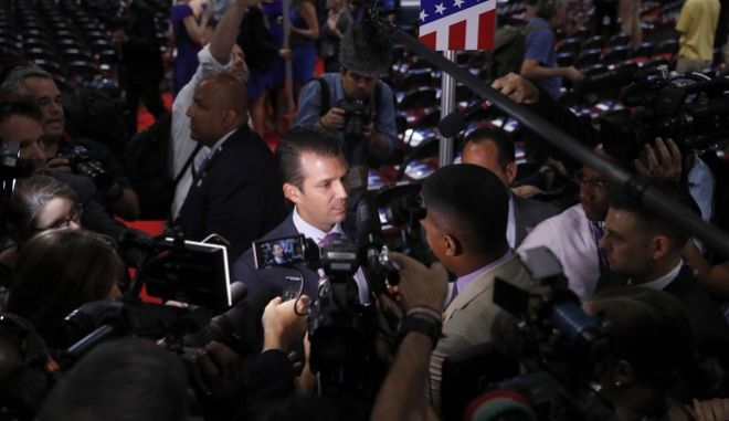 Donald Trump Jr., son of of Republican Presidential Candidate Donald Trump, is surrounded by journalists as he talks to reporters after his sound check before the start of the second day session of the Republican National Convention in Cleveland, Tuesday, July 19, 2016. (AP Photo/Carolyn Kaster)