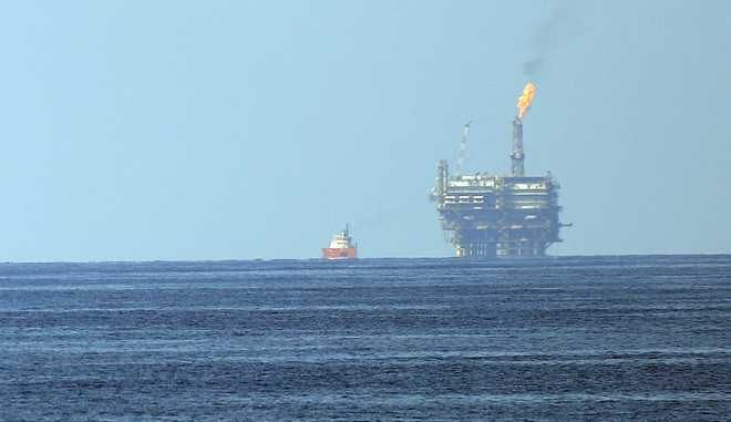 """Eni's Bouri Offshore oil terminal is seen off the Libyan coast, in the Mediterranean sea, Tuesday, Aug. 1, 2015. The Italian energy company Eni SpA announced Sunday, Aug. 30, 2015, it has discovered a """"supergiant"""" natural gas field off Egypt, describing it as the """"largest-ever"""" found in the Mediterranean Sea. (AP Photo/Gregorio Borgia)"""