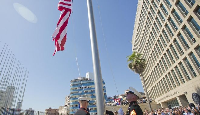 U.S. Marines raise the U.S. flag over the newly reopened embassy in Havana, Cuba. Friday, Aug. 14, 2015. U.S. Secretary of State John Kerry traveled to the Cuban capital to raise the U.S. flag and formally reopen the long-closed U.S. Embassy. Cuba and U.S. officially restored diplomatic relations July 20, as part of efforts to normalize ties between the former Cold War foes. (AP Photo/Pablo Martinez Monsivais,Pool)