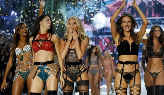 Models, from left, Jasmine Tookes, Adriana Lima, Lily Donaldson, Alessandra Ambrosio, and Taylor Hill acknowledge applause during the Victoria's Secret Fashion Show inside the Grand Palais, in Paris, Wednesday, Nov. 30, 2016. The pulse-quickening, celebrity-filled catwalk event of the year : the Victoria's Secret fashion show takes place in Paris with performances from Lady Gaga and Bruno Mars. (AP Photo/Francois Mori)