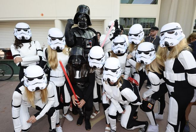 Fans dressed as Star Wars characters pose in front of the convention center on day three of the Comic-Con International held at the San Diego Convention Center Saturday, July 23, 2016 in San Diego.  (Photo by Denis Poroy/Invision/AP)