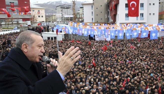 Turkey's President and leader of ruling Justice and Development Party Recep Tayyip Erdogan addresses the members of his party, in Hakkari, southeastern Turkey, Saturday, Dec. 23, 2017. (Kayhan Ozer/Pool Photo via AP)