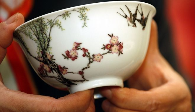 A Chinese ceramic bowl dating from the 18th century is displayed at Christie's auction house in Hong Kong Tuesday, Nov. 28, 2006. The famille rose bowl, from the court of Emperor Qianlong's 1736-1795 reign was sold  for HK$151 million (US$19.42 million; euro14.81 million), breaking the world record price for Qing dynasty ceramics, Christie's said. (AP Photo/Vincent Yu)