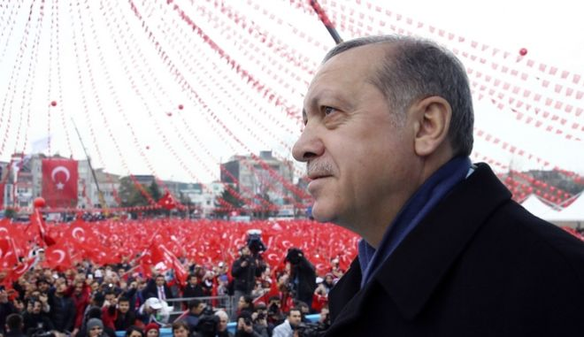 Turkey's President Recep Tayyip Erdogan addresses his supporters in Sakarya, Turkey, Thursday, March 16, 2017. Erdogan threatened on Thursday to scrap a deal with the European Union to readmit migrants who have crossed illegally into Europe, amid a standoff with European nations over their reluctance to allow Turkish ministers to hold campaign rallies in their countries.(Kayhan Ozer/Presidential Press Service, Pool Photo via AP)