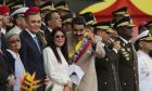 Venezuela's President Nicolas Maduro, center right, and his wife Cilia Florez, center left, pose for photos during Army Day celebrations at Fuerte Tiuna, in Caracas, Venezuela, Saturday, June 24, 2017. Maduro joined the army celebrations as thousands marched in the streets of the capital to demand restraint from government security forces after more than 70 people have been killed during almost 90 days of protests seeking his removal. (AP Photo/Fernando Llano)