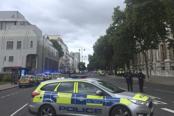 Armed police at the scene on Cromwell Gardens in London, near where people were injured after a car reportedly ploughed into people outside London's Natural History Museum, Saturday Oct. 7, 2017. Police say a number of people have been injured and one person has been detained at the scene. The crash happened at 2:20 p.m. on a day when the central London museum is usually teeming with pedestrians including international tourists .(Henry Vaughan/PA via AP)