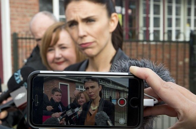 New Zealand Labour Party leader Jacinda Ardern, front, is filmed on mobile phone during a media announcement during a visit to Addington School in Christchurch, New Zealand, Wednesday, Aug. 16, 2017. New Zealand will hold a general election on Saturday, Sept. 23, 2017. (AP Photo/Mark Baker)