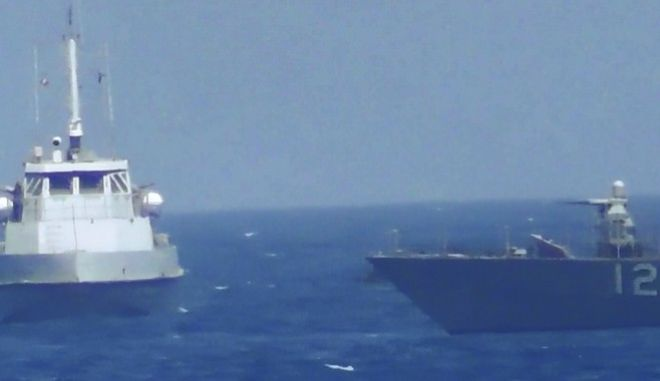 This handout image provided Tuesday, July 25, 2017, from the U.S. Navy purports to show an Iranian vessel making a close approach to a U.S. coastal patrol ship USS Thunderbolt, right. The U.S. Navy patrol boat fired warning shots near the Iranian vessel that American sailors said came dangerously close to them during a tense encounter in the Persian Gulf. Iran's Revolutionary Guard later blamed the American ship for provoking the situation. (U.S. Navy via AP)