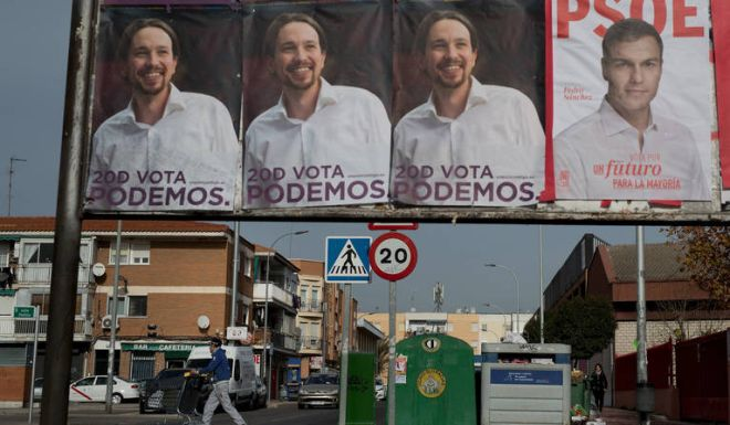 PARLA, SPAIN - DECEMBER 17:  A man crosses a road pushing a trolley loaded with scrap as general elections campaign posters sitck to a placard on December 17, 2015 in Parla, near Madrid, Spain. Over 36 million Spaniards will flock to the polls on Sunday December 20, 2015 to vote for 350 members of the parliament and 208 senators. For the first time since 1982, the two traditional Spanish political parties, right-wing Partido Popula (People's Party) and centre-left wing Partido Socialista Obrero Espanol PSOE (Spanish Socialist Workers' Party), are holding a tight election race with two new contenders, Ciudadanos (Citizens) and Podemos (We Can) attracting right-leaning and left-leaning voters respectively.  (Photo by Pablo Blazquez Dominguez/Getty Images)