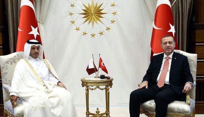 Turkey's President Recep Tayyip Erdogan, right, and Prime Minister of Qatar Adbdullah bin Nasser bin Khalifa Al Thani sit prior to their meeting in Ankara, Turkey, Thursday, Sept. 8, 2016.(Yasin Bulbul/Pool Photo via AP)
