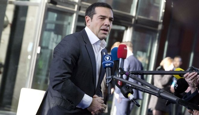 Greek Prime Minister Alexis Tsipras, right, speaks with the media as he arrives for an EU summit in Goteborg, Sweden on Friday, Nov. 17, 2017. European Union leaders warned Britain Friday that it must do much more to convince them that Brexit talks should be broadened to future relations and trade from December. (AP Photo/Virginia Mayo)