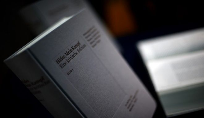 """A copy of """"Hitler, Mein Kampf  A critical edition"""" is presented prior to a news conference in Munich, Germany, Friday, Jan. 8, 2016. The annotated edition of """"Mein Kampf"""" is the first version of Adolf Hitler's notorious manifesto to be published in Germany since the end of World War II. (AP Photo/Matthias Schrader)"""