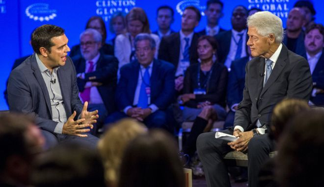 Greece's Prime Minister Alexis Tsipras (L) speaks with former U.S. President Bill Clinton (R) during a conversation at the Clinton Global Initiative's annual meeting in New York, September 27, 2015.  REUTERS/Lucas Jackson