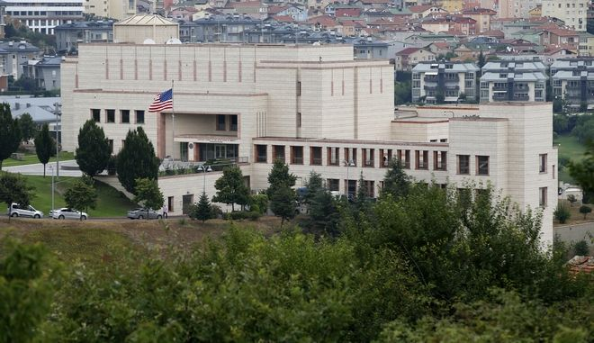 A view of the United States consulate building in Istanbul, Turkey, Tuesday, Aug. 11, 2015. On Tuesday the U.S. consulate reopened for business, a day after two women opened fire at the heavily protected building. No one was hurt in the attack which was claimed by an outlawed far-left group. Both assailants fled; one suspect was later shot and taken into custody. (AP Photo/Emrah Gurel)