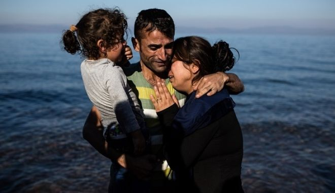 Migrants and refugees arrive in a shore near Eftalou in the north of Lesbos island, Greece on November 14, 2015.
