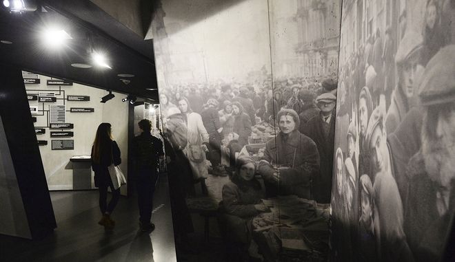 Visitors to the POLIN Museum of the History of Polish Jews look at exhibits from the Warsaw Ghetto of the World War II, in Warsaw, Poland, Thursday, Feb. 1, 2018. Poland and Israel are locked in a bitter dispute over Poland's new legislation that is to regulate Holocaust speech. (AP Photo/Czarek Sokolowski)