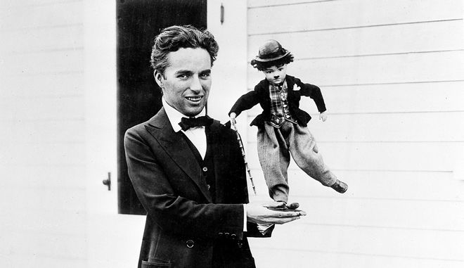 "Charlie Chaplin holds a puppet doll of the Tramp in Hollywood, Ca., in 1917.  Chaplin originated the Tramp character in the 1914 silent film, ""Kid Auto Races at Venice.""  (AP Photo)"