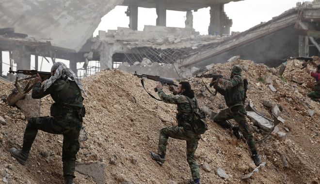 Syrian army soldiers fire their weapons during a battle with rebel fighters at the Ramouseh front line, east of Aleppo, Syria, Monday, Dec. 5, 2016. The government seized large swaths of the Aleppo enclave under rebel control since 2012 in the offensive that began last week. The fighting was most intense Monday near the dividing line between east and west Aleppo as government and allied troops push their way from the eastern flank, reaching within less than a kilometer (half a mile) from the citadel that anchors the center of the city. (AP Photo/Hassan Ammar)