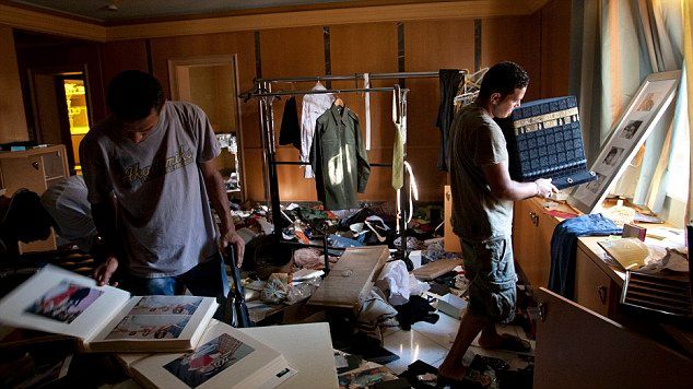 Rebel fighters search in the house of Aisha Gadhafi the daughter of Libyan dictator Moammar Gadhafi in Tripoli, LIbya, Wednesday, Aug. 24, 2011.  (AP Photo/Sergey Ponomarev)