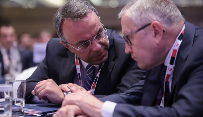 Ο Υπουργός Οικονομικών Χ.Σταϊκούρας και ο Κλάους Ρέγκλινγκ στο πρόσφατο συνέδριο του Economist