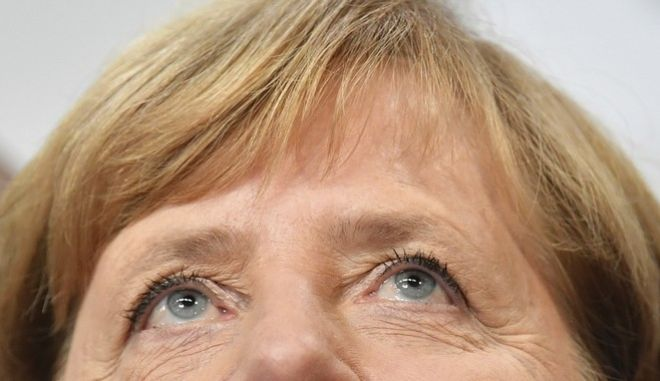 German Chancellor Angela Merkel arrives for  a statement on the parliament election at the headquarters of the Christian Democratic Union CDU in Berlin, Germany, Sunday, Sept. 24, 2017.  (Boris Roessler/dpa via AP)